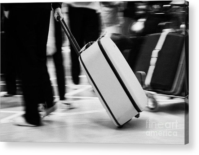 Europe Acrylic Print featuring the photograph man pulling red wheeled luggage out of Reina Sofia Sur TFS South Airport Tenerife Canary Islands Spain by Joe Fox