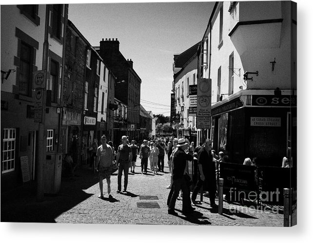 Galway Acrylic Print featuring the photograph pedestrians walking down closed pedestrian area of quay street on sunny sunday afternoon Galway city by Joe Fox