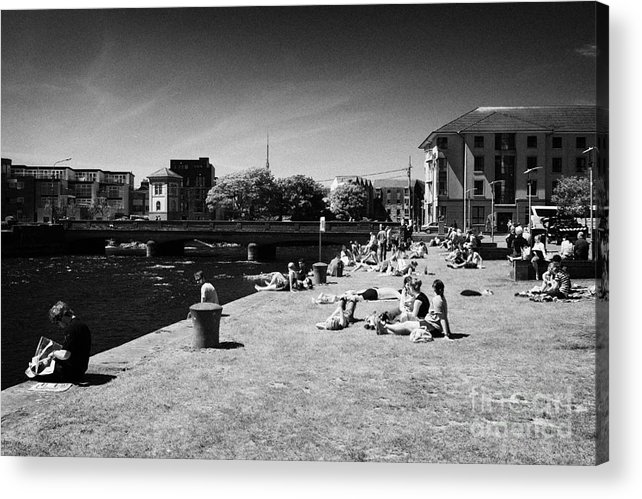 Galway Acrylic Print featuring the photograph people enjoying the sunshine on the quay next to the corrib river on a sunday afternoon Galway city by Joe Fox
