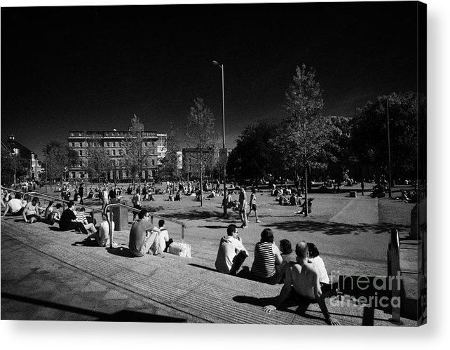 Galway Acrylic Print featuring the photograph people sitting enjoying the sunshine Eyre Square in the heart of Galway city county Galway Republic of Ireland by Joe Fox