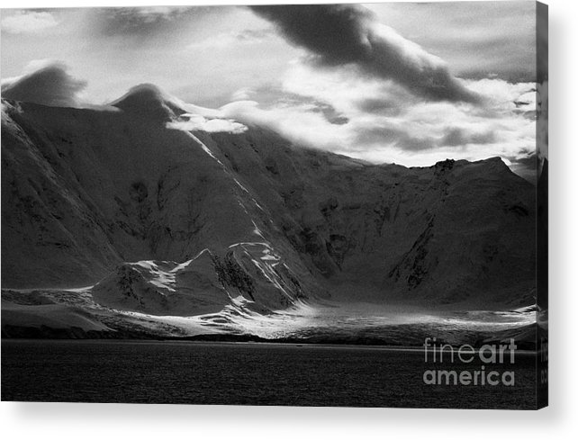 Snow Acrylic Print featuring the photograph sunlight breaking through clouds on snow covered landscape of anvers island and neumayer channel Ant by Joe Fox