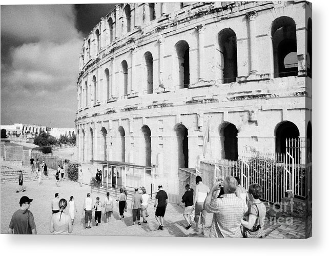 Tunisia Acrylic Print featuring the photograph Tourists Walk Down Steps Towards The Main Entrance Of The Old Roman Colloseum Against Blue Cloudy Sky El Jem Tunisia by Joe Fox