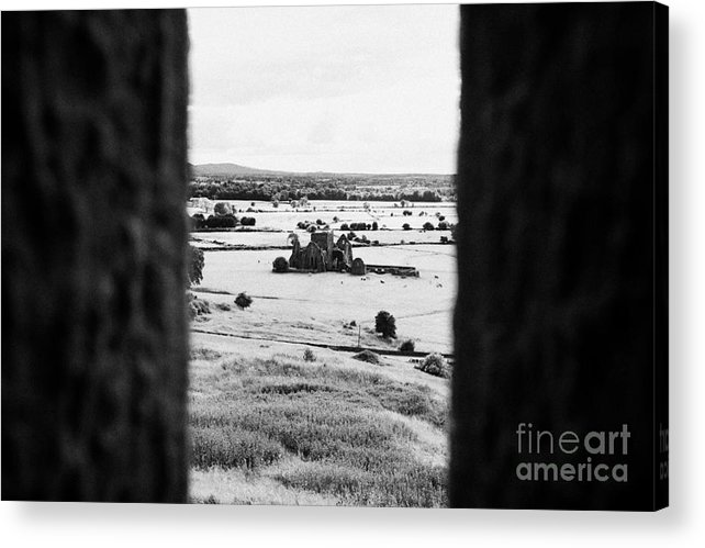 Ireland Acrylic Print featuring the photograph viewpoint looking out through stone fortifications towards hore abbey from the Rock of Cashe by Joe Fox