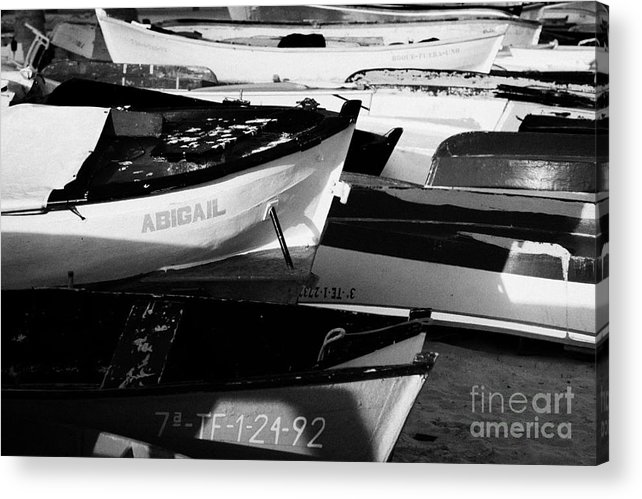 Europe Acrylic Print featuring the photograph wooden colourful fishing boats and dinghys sitting on the beach at las teresitas Tenerife Canary Islands Spain by Joe Fox