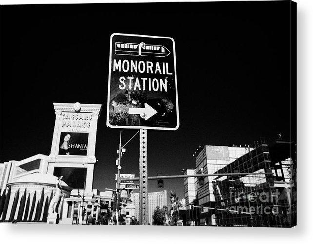 Las Vegas Acrylic Print featuring the photograph signpost for Las Vegas monorail station on las vegas boulevard Nevada USA by Joe Fox