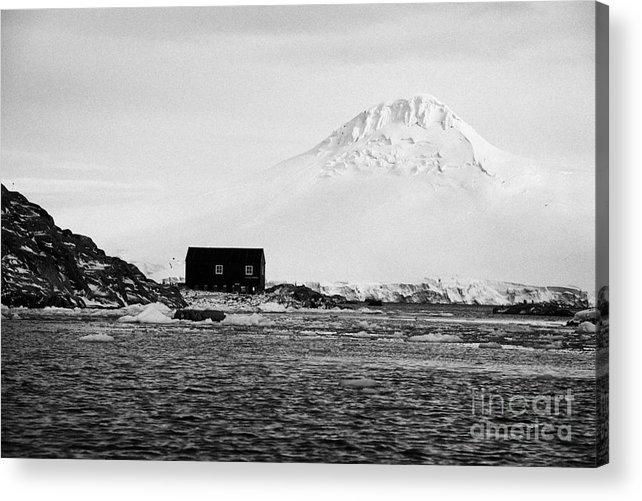 Boathouse Acrylic Print featuring the photograph boathouse on goudier island port lockroy with doumer island hill Antarctica by Joe Fox