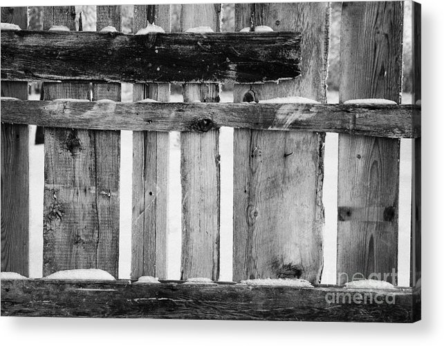 Old Acrylic Print featuring the photograph old patched up wooden fence using old bits of wood in snow Forget by Joe Fox