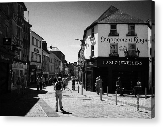 Galway Acrylic Print featuring the photograph people walking down pedestrian area william street on a sunday Galway city county Galway Republic of by Joe Fox