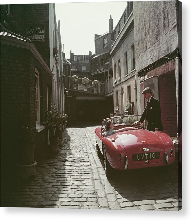 People Acrylic Print featuring the photograph Sports Car Couple by Slim Aarons