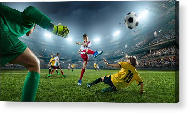 Soccer Uniform Acrylic Print featuring the photograph Soccer kids players scoring a goal. Goalkeeper tries to hit the ball by Aksonov
