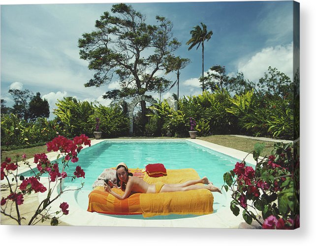 Artist Acrylic Print featuring the photograph Sunbathing In Barbados by Slim Aarons