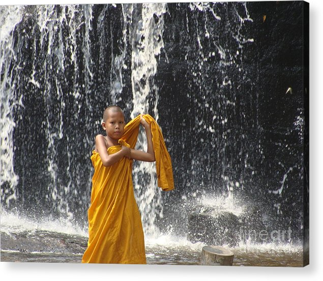 Buddhism Acrylic Print featuring the photograph Young Monk In Front Of Waterfall by Jarrod Brown