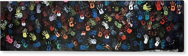 Child Acrylic Print featuring the photograph A Painting Of Colorful Handprints by Khananastasia
