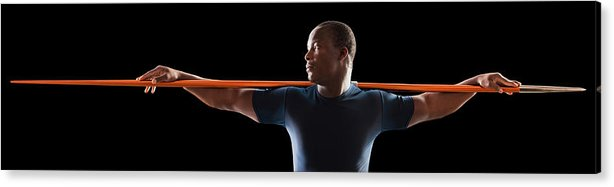 Young Men Acrylic Print featuring the photograph African American Man Holding Track And by Mike Kemp