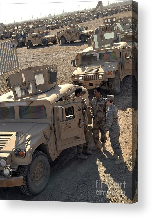 M1114 Acrylic Print featuring the photograph U.s. Army Soldier Speaks With Iraqi by Stocktrek Images