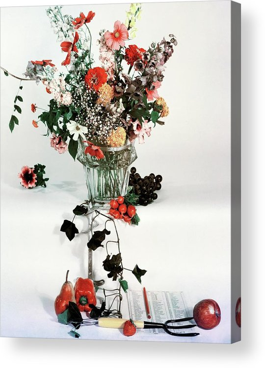 Nobody Acrylic Print featuring the photograph A Studio Shot Of A Vase Of Flowers And A Garden by Herbert Matter