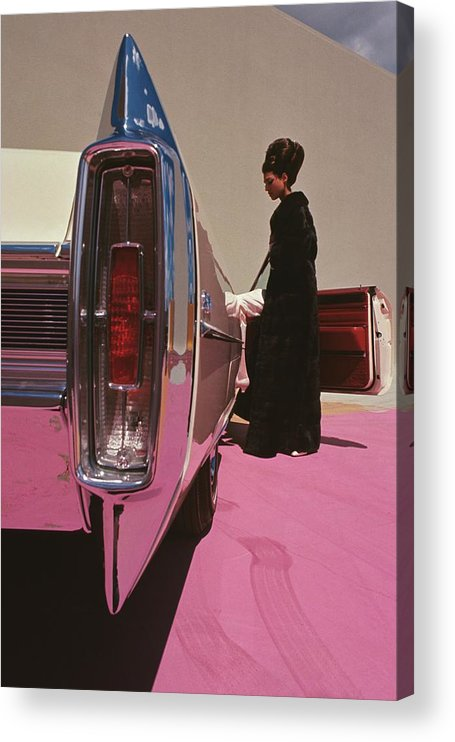 Auto Acrylic Print featuring the photograph A Model Wearing Emeric Partos Entering A 1965 by Gene Laurents
