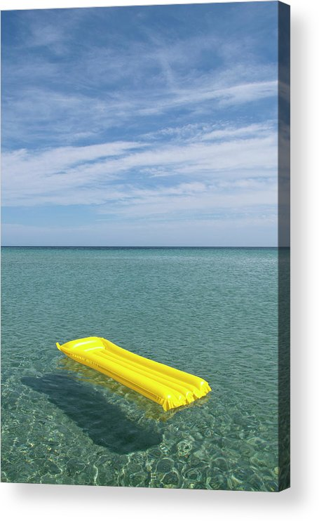 Tranquil Scene Acrylic Print featuring the photograph A Yellow Inflatable Raft Floating On by Caspar Benson