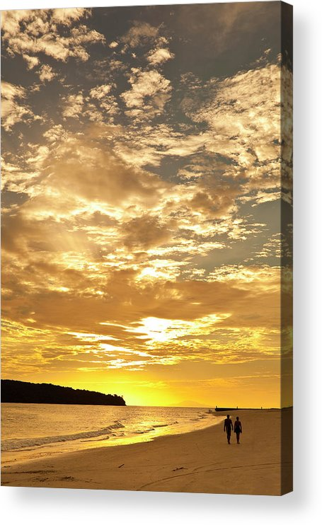 Scenics Acrylic Print featuring the photograph Couple Walking On Beach At Sunset by Richard I'anson