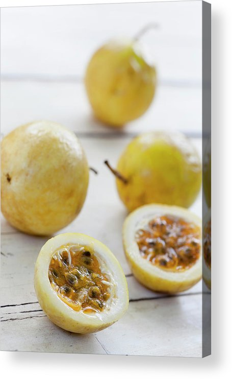 Raw Food Diet Acrylic Print featuring the photograph Passion Fruit On A Table by Enviromantic
