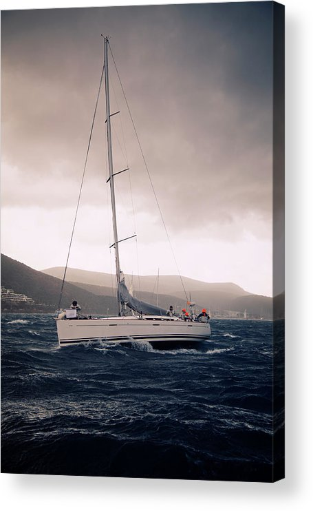 Recreational Pursuit Acrylic Print featuring the photograph Sailing And Stormy Weather by Travenian