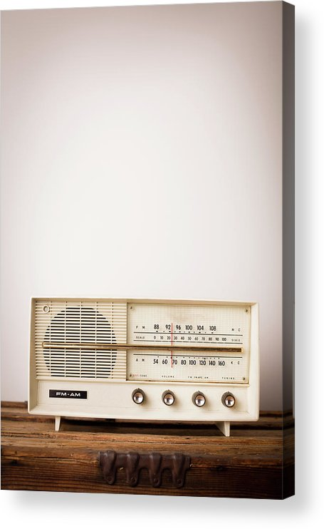 Desaturated Acrylic Print featuring the photograph Vintage Beige Radio Sitting On Wood by Ideabug