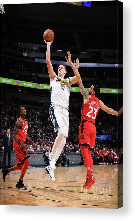 Nba Pro Basketball Acrylic Print featuring the photograph Toronto Raptors V Denver Nuggets by Garrett Ellwood