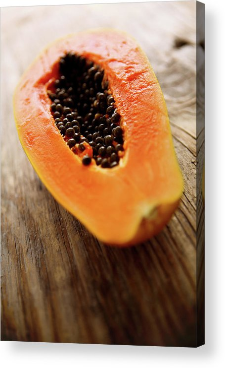 Serving Size Acrylic Print featuring the photograph A Halved Fresh Papaya On A Wooden by Chang