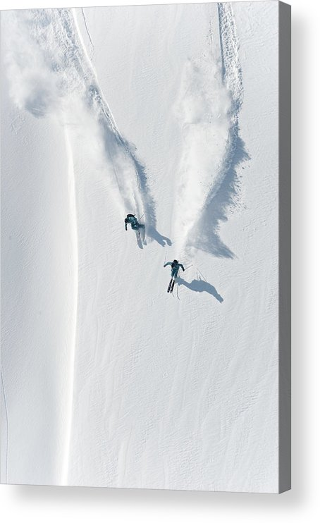 Crash Helmet Acrylic Print featuring the photograph Aerial View Of Two Skiers Skiing by Creativaimage