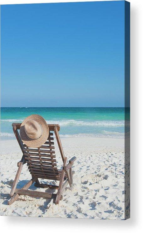 Scenics Acrylic Print featuring the photograph Beach Chair With A Hat On An Empty Beach by Sasha Weleber