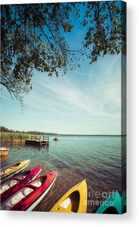 Wilkasy Acrylic Print featuring the photograph Colorful Kayaks Moored On Lakeshore by Curioso