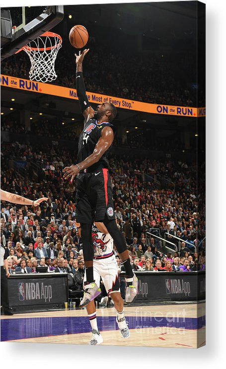 Patrick Patterson Acrylic Print featuring the photograph La Clippers V Toronto Raptors by Ron Turenne