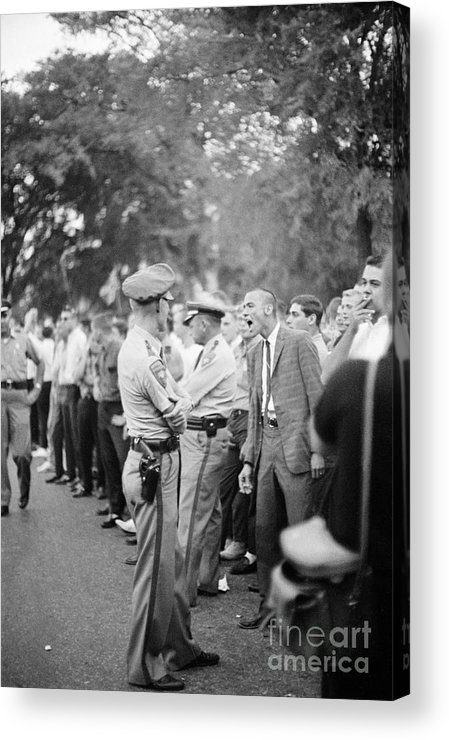 People Acrylic Print featuring the photograph Student Insults Police During Riot by Bettmann