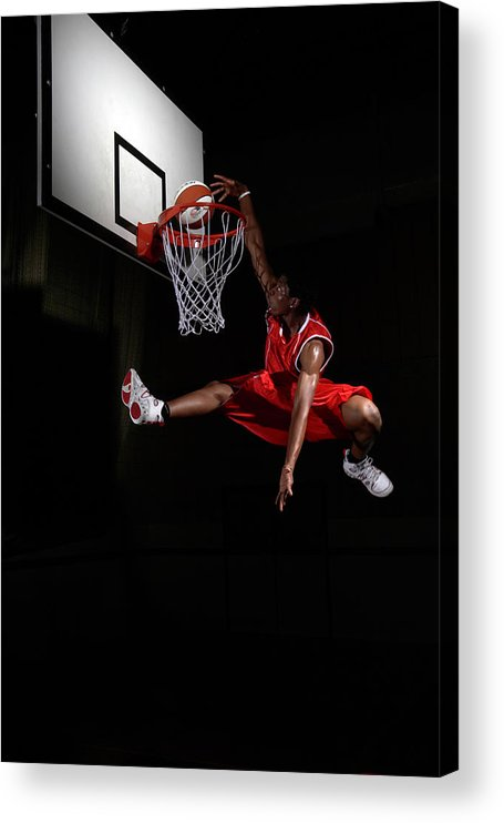 Human Arm Acrylic Print featuring the photograph Young Man Making A Fancy Dunk by Compassionate Eye Foundation/steve Coleman/ojo Images Ltd