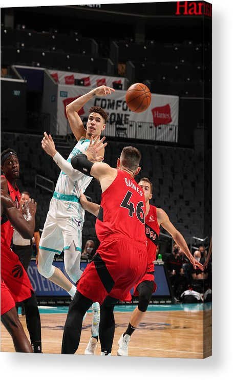 Nba Pro Basketball Acrylic Print featuring the photograph Toronto Raptors v Charlotte Hornets by Kent Smith