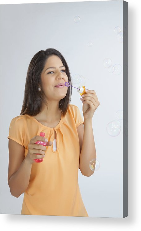 People Acrylic Print featuring the photograph Young woman blowing soap bubbles by Ravi Ranjan