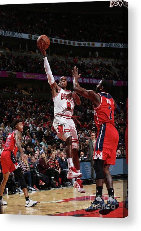 Nba Pro Basketball Acrylic Print featuring the photograph Rajon Rondo by Gary Dineen