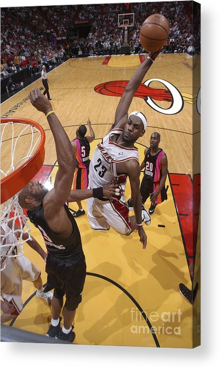 Nba Pro Basketball Acrylic Print featuring the photograph Alonzo Mourning and Lebron James by Andrew D. Bernstein