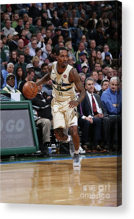 Nba Pro Basketball Acrylic Print featuring the photograph Brandon Jennings by Gary Dineen