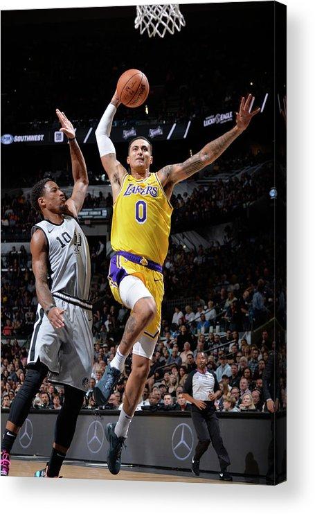 Nba Pro Basketball Acrylic Print featuring the photograph Demar Derozan and Kyle Kuzma by Mark Sobhani