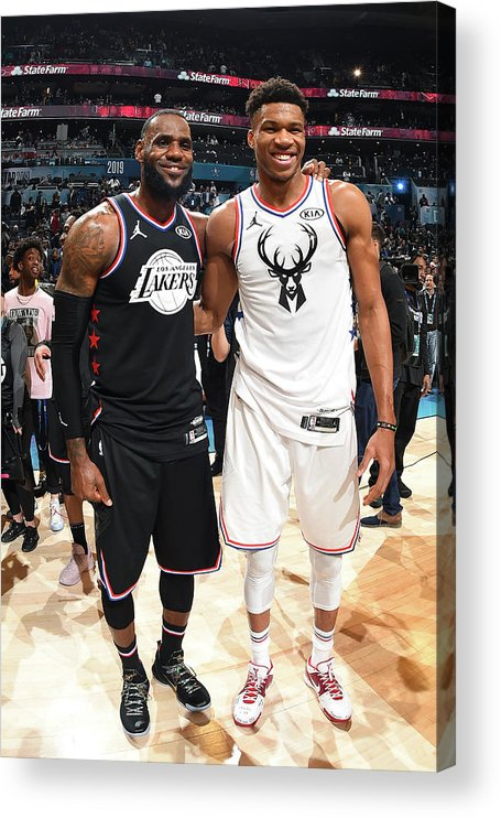 Nba Pro Basketball Acrylic Print featuring the photograph Giannis Antetokounmpo and Lebron James by Andrew D. Bernstein