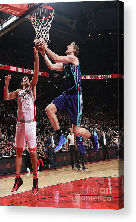 Nba Pro Basketball Acrylic Print featuring the photograph Luis Scola and Cody Zeller by Ron Turenne