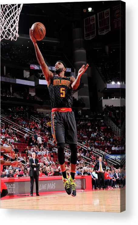 Nba Pro Basketball Acrylic Print featuring the photograph Malcolm Delaney by Bill Baptist