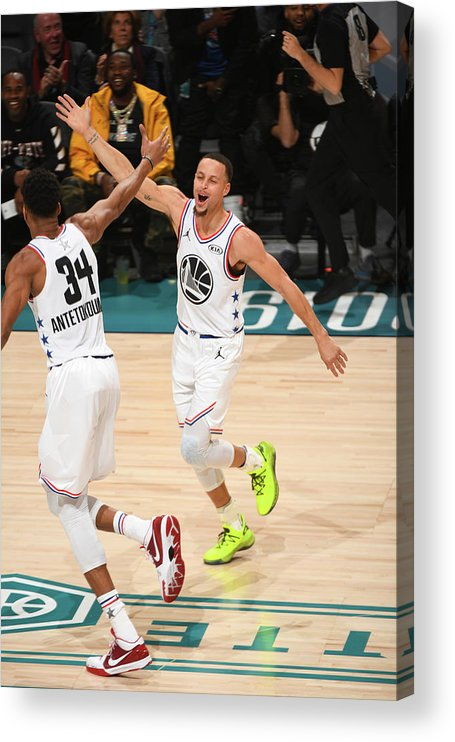 Nba Pro Basketball Acrylic Print featuring the photograph Stephen Curry and Giannis Antetokounmpo by Garrett Ellwood