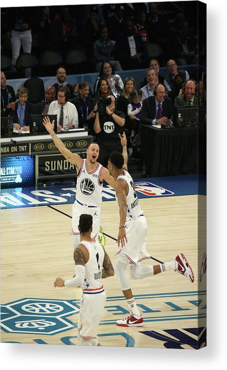Following Acrylic Print featuring the photograph Stephen Curry and Giannis Antetokounmpo by Gary Dineen