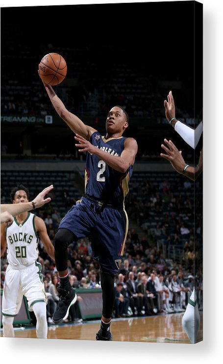 Nba Pro Basketball Acrylic Print featuring the photograph Tim Frazier by Gary Dineen