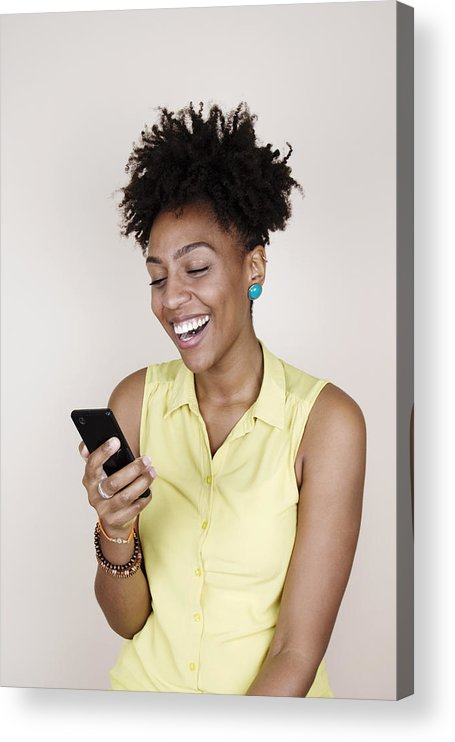Youth Culture Acrylic Print featuring the photograph Woman smiling using phone by Flashpop