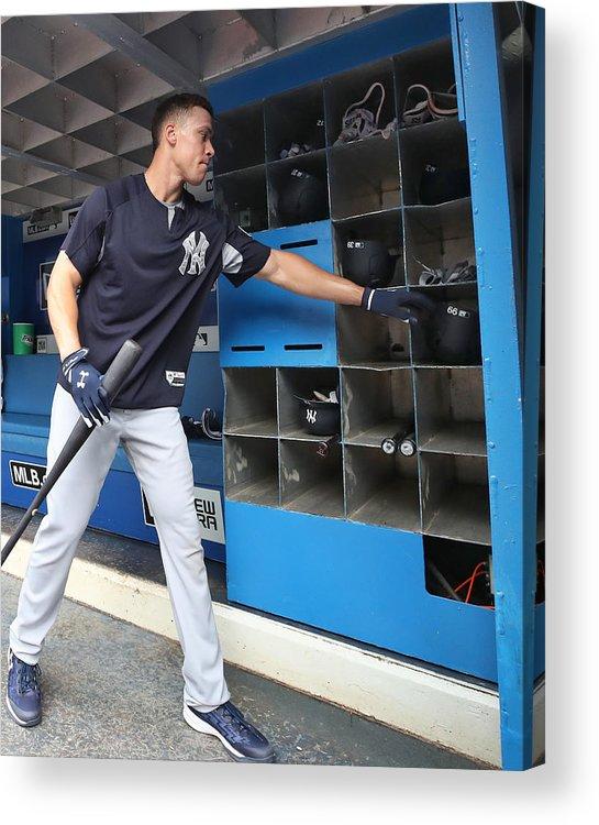 Headwear Acrylic Print featuring the photograph New York Yankees v Toronto Blue Jays by Tom Szczerbowski
