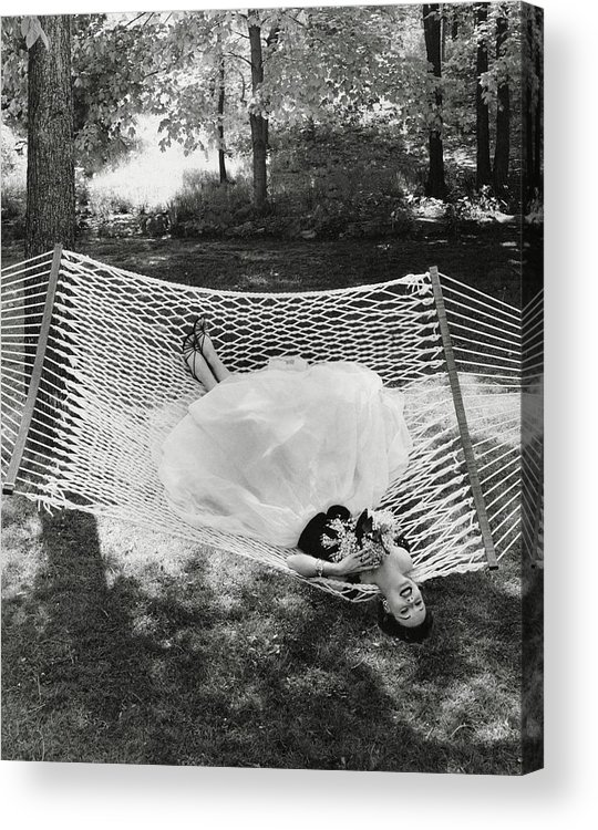Landscape Acrylic Print featuring the photograph A Model Lying On A Hammock by Gene Moore