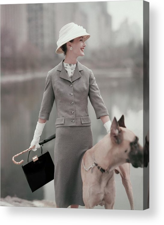 Fashion Acrylic Print featuring the photograph A Model Wearing A Gray Suit With A Dog by Karen Radkai